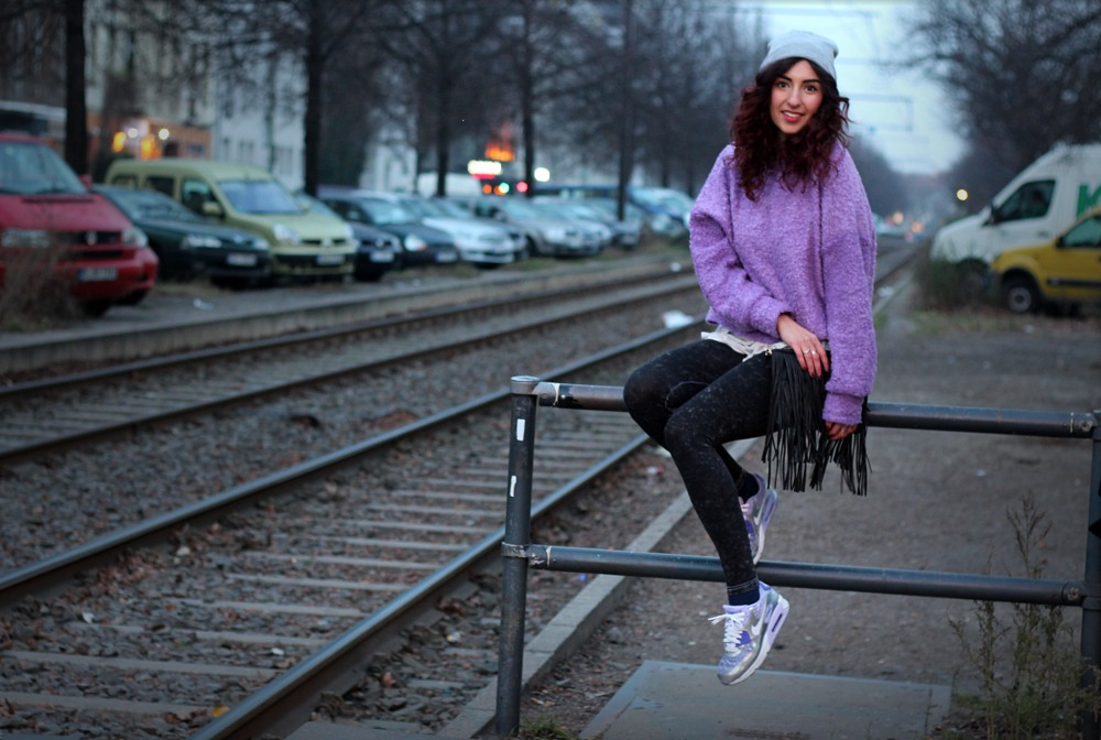 fuzzy sweater and silver sneakers