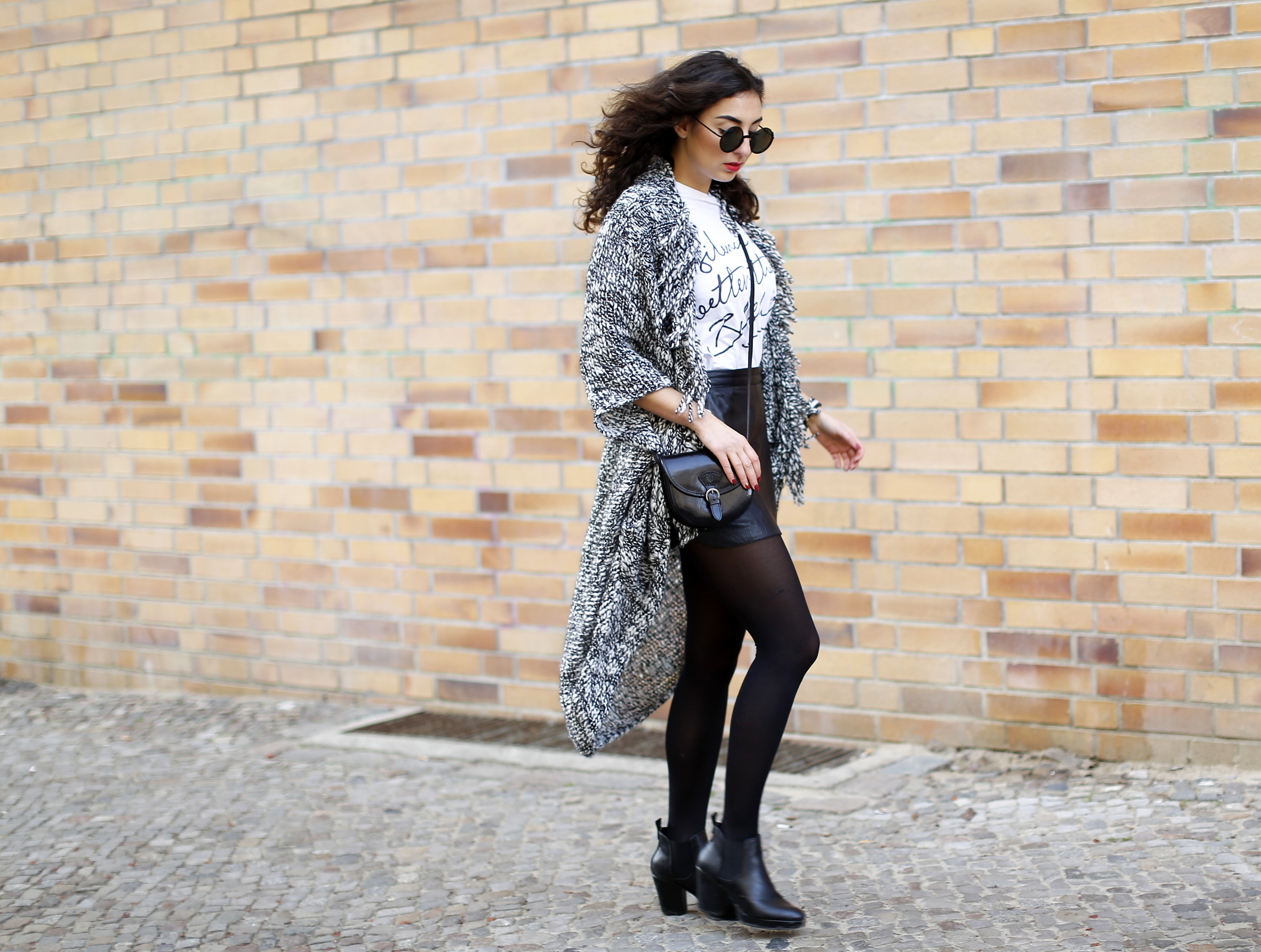 esprit long cardigan outfit black and white look black leather skirt  streetstyle berlin look motto shirt ... 58e456e3c